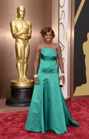 Viola Davis selected a strapless emerald A-line Escada gown with an asymmetrical neckline for the 2014 Academy Awards.
