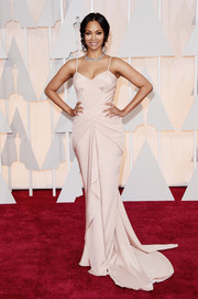 Zoe Saldana sported an hourglass silhouette in a figure-hugging pale-pink slip dress by Atelier Versace during the Oscars.