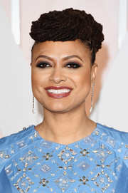 Ava DuVernay topped off her Oscars look with funky upswept dreadlocks.