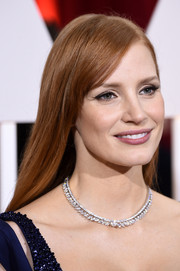 Jessica Chastain was all about simple elegance with her long straight 'do and side-swept bangs at the Oscars.