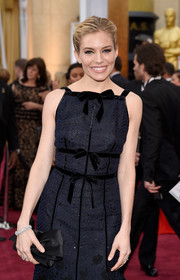 Sienna Miller polished off her look with a gorgeous diamond bracelet and a matching ring.