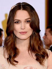 Keira Knightley was a boho princess at the Oscars with her center-parted waves, complete with a bedazzled headband.