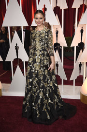 Georgina Chapman was all about opulent elegance at the Oscars in a black gown adorned all over with gold floral embroidery.