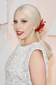 Lady Gaga's red lipstick looked jarring against her white complexion.