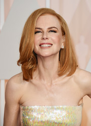 Nicole Kidman attended the Oscars wearing her hair down in a mid-length bob with a bit of wave on one side.