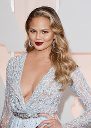 Chrissy Teigen sealed off her look with a sexy deep-red shade of lipstick.