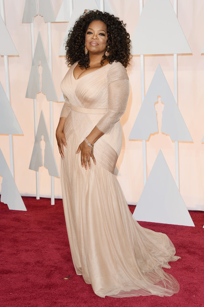 Oprah Winfrey made a very stylish appearance at the Oscars in a nude Vera Wang gown with a plunging neckline and crisscross detailing.