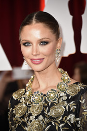 Georgina Chapman accessorized with a beautiful flower statement necklace that echoed the style of her dress.