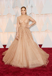 Jennifer Lopez knew just how to steal the show when she attended the Oscars, wearing a heavenly Elie Saab Couture gown boasting a beaded midsection, a deep-V plunge, and a dramatic tulle skirt.