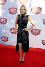 Carrie Keagan looked fiercely chic in an embellished black fishtail dress at the American Country Awards.