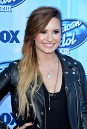 Demi Lovato finished off her bling with a long silver chain.