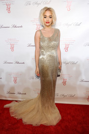 Rita Ora was ultra glam at the Angel Ball in a beaded gold Donna Karan gown featuring a tulle train.