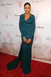 Selita Ebanks oozed Old Hollywood glamour at the Angel Ball in a long-sleeve teal Roberto Cavalli gown with an embellished neckline and a long train.