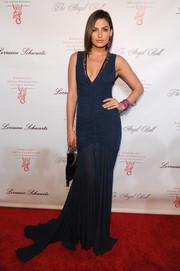 Alyssa Miller looked sensual in a ruched navy evening dress during the Angel Ball.