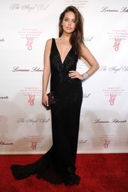 Emily DiDonato looked ravishing in a low-cut beaded black gown by Roberto Cavalli during the Angel Ball.