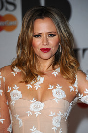 Kimberley Walsh attended the Brit Awards wearing an edgy tousled 'do.