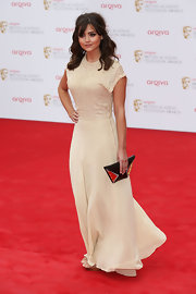 Jenna-Louise Coleman chose a classic nude dress that featured a lace top and flowing skirt, which gave her a soft and romantic look on the red carpet.