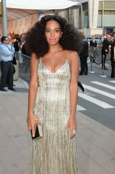 Solange Knowles went for high shine with this mirrored box clutch and sequined dress combo at the CFDA Fashion Awards.