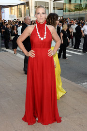 Busy Philipps looked ultra feminine in a sleeveless, high-neck red gown by Honor at the CFDA Fashion Awards.