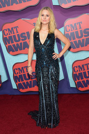 Kristen Bell went for hight sparkle in a fully beaded blue gown by Zuhair Murad at the CMT Music Awards.