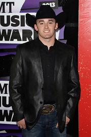 Austin Dillon wasn't afraid to flaunt his western roots in a black cowboy hat at the CMT Music Awards.
