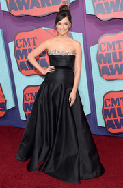 Kacey Musgraves looked very princess-y at the CMT Music Awards in a black Miu Miu strapless gown with a bejeweled neckline and a voluminous skirt.
