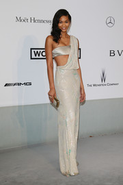 Chanel Iman showed some skin in a silver Reem Acra one-shoulder gown with a bandeau underlay during the Cinema Against AIDS Gala.
