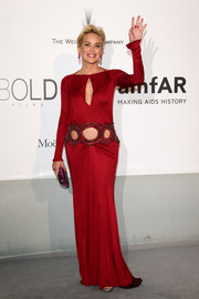 Sharon Stone made a bold choice with this red Roberto Cavalli gown, featuring a keyhole neckline and belly-baring cutouts, for the Cinema Against AIDS Gala.