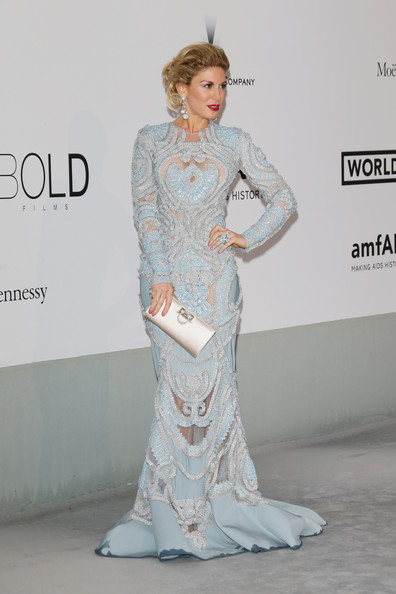 Hofit Golan finished off her outfit in classic style with an ivory satin clutch by Ferragamo.