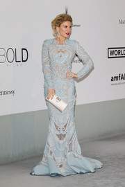 Hofit Golan glammed it up in an intricately embellished pastel-blue gown with sheer inserts during the Cinema Against AIDS Gala.