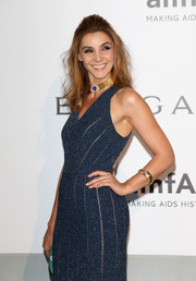 Clotilde Courau paired a chunky gold bracelet with a fitted blue dress for the 2014 amfAR Cinema Against AIDS Gala.