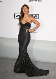 Nicole Scherzinger sent temperatures rising with this cleavage-baring strapless gown by Michael Costello during the Cinema Against AIDS Gala.