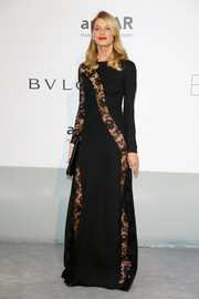 Angela Lindvall looked seductively sophisticated at the Cinema Against AIDS Gala in a black Redemption Choppers gown with see-through lace panels.