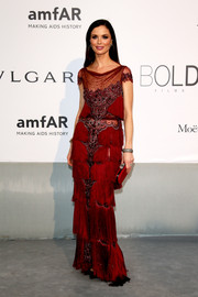 Georgina Chapman was Art Deco-glam in a fringed red sheer-panel gown at the Cinema Against AIDS Gala.