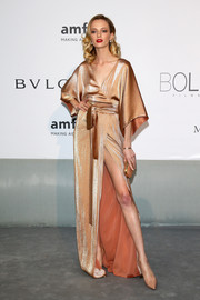 Daria Strokous looked ultra sophisticated at the Cinema Against AIDS Gala in a kimono-inspired gold wrap dress with an up-to-there slit.