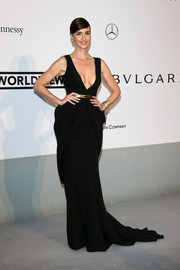 Paz Vega was sultry yet elegant at the Cinema Against AIDS Gala in a black Fitriani Couture gown featuring a provocative neckline and sculptural skirt detail.