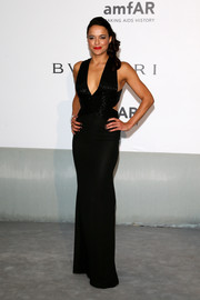 Michelle Rodriguez channeled Old Hollywood in a low-cut black Elisabetta Franchi gown that hugged her svelte figure wonderfully.