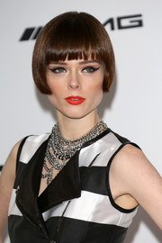 Coco Rocha added major edge to her look with layers of silver chain necklaces.