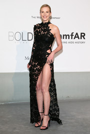 Anne V looked super daring at the Cinema Against AIDS Gala in a black one-sleeve Redemption Choppers macrame gown with a way-up-to-there slit.