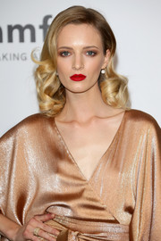 Daria Strokous attended the Cinema Against AIDS Gala looking like an Old Hollywood star with her sculpted curls and bold red lips.
