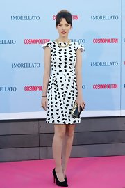 Leticia Dolera stuck to a simple white capped-sleeve dress with black printed detailing.