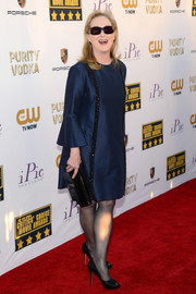 Meryl Streep chose a simple yet classy blue Stella McCartney dress with bell sleeves and beading down both sides for the Critics' Choice Awards.