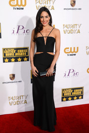 Brie Bella looked ultra modern at the Critics' Choice Awards in a black column dress with cleavage and waist cutouts.