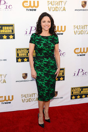 Julia Louis-Dreyfus went for a classic, ladylike look with this green lace cocktail dress by Reem Acra during the Critics' Choice Awards.