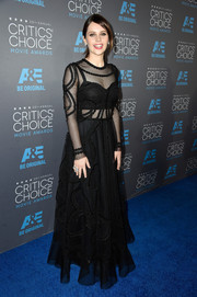 Felicity Jones arrived at the Critics' Choice Movie Awards wearing a beautiful embroidered gown with sheer details.