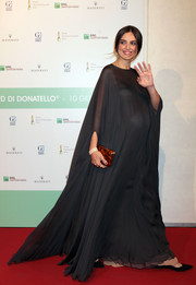 Kasia Smutniak showed off her elegant maternity style with this floor-sweeping black gown at the David Di Donatello Awards.