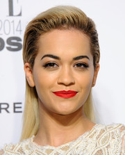 Rita Ora added major sexiness to her beauty look with a swipe of bold red lipstick.