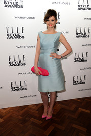 Sophie Ellis-Bextor topped off her vintage-themed ensemble with a pretty pink frame clutch.