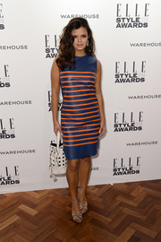 Bip Ling teamed her dress with a pair of stylish taupe platform sandals.