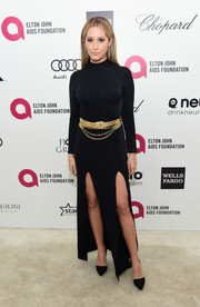 Ashley Tisdale looked cool and sophisticated at Elton John's Oscar-viewing party in a long-sleeve black turtleneck dress with double slits.